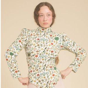 Samantha Pleet illuminated manuscript bodysuit